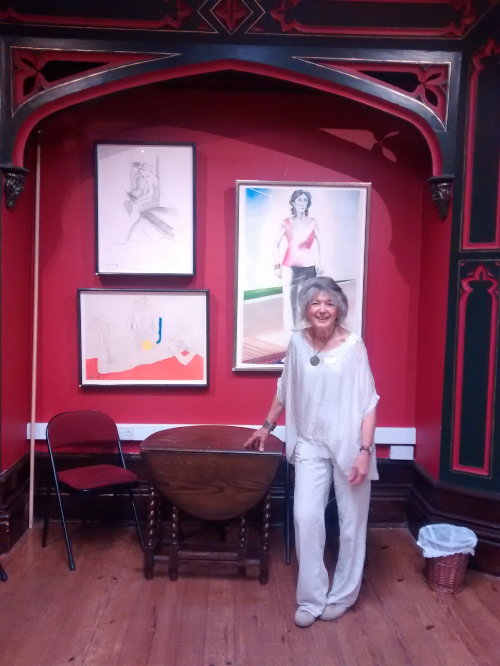 Margaret Crowther in front of Cecile Elstein's drawings · photo by Lynne Duric