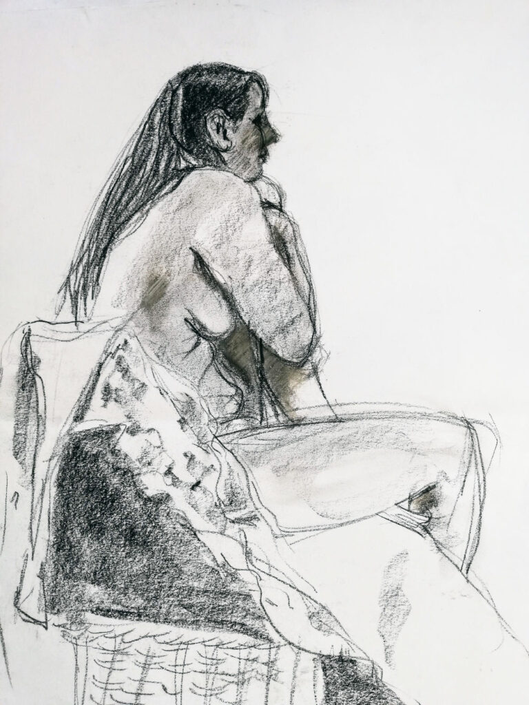 Model, seated in cane chair