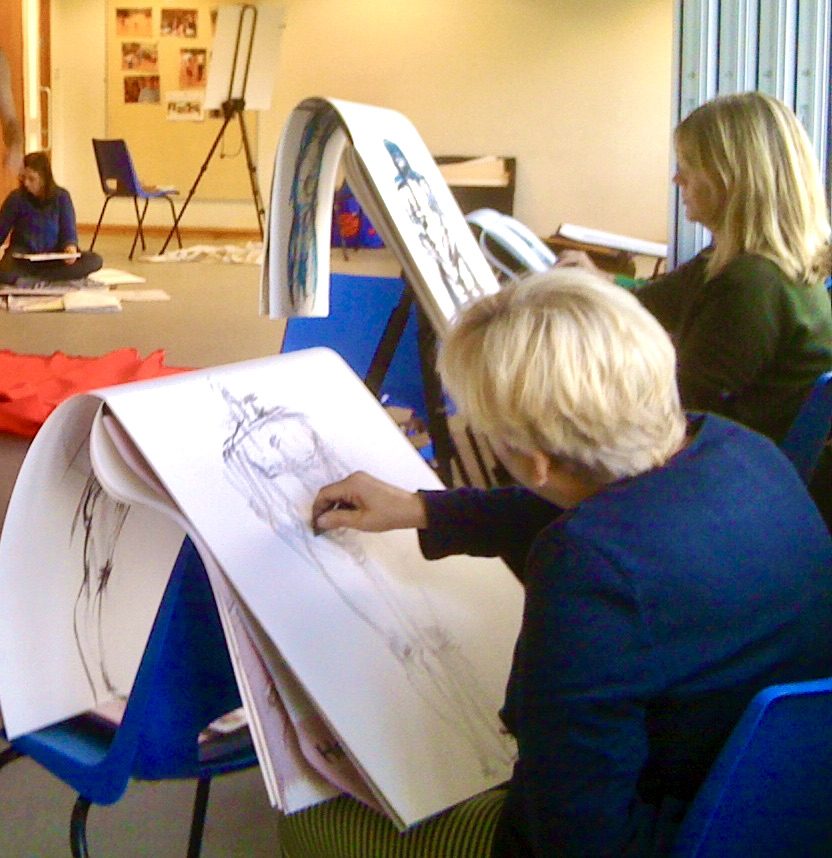 Artists at work during a session in the upper hall at the St. James and Emmanuel Church